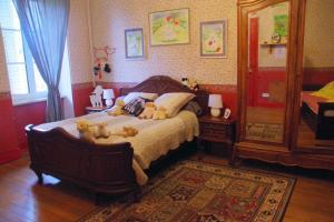 Un ou plusieurs lits dans un hébergement de l'établissement Chambres d'hôtes Au presbytère