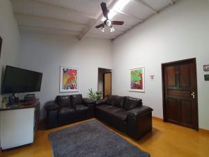 Uma área de estar em Casa Franco Hospedaria