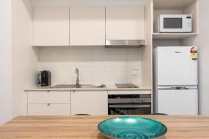 A kitchen or kitchenette at Terminus Apartment Hotel (formerly Quality Apartments City Centre Newcastle)