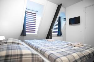Een bed of bedden in een kamer bij B&B Hotel Lichtstad