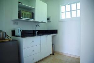 A kitchen or kitchenette at Bequia Plantation Hotel