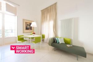 Area soggiorno di Gattopardo Apartments By LAGO Design