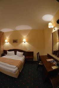 Cama o camas de una habitación en Coroana Brasovului