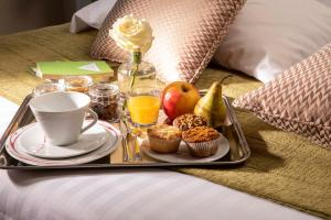 Breakfast options available to guests at Hotel Relais Bosquet