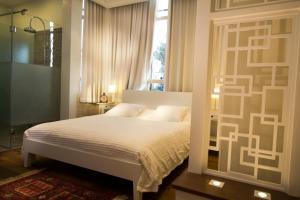 Postelja oz. postelje v sobi nastanitve Haifa Luxury Boutique Apartments