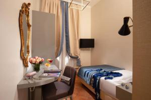 Télévision ou salle de divertissement dans l'établissement Hotel Mozart