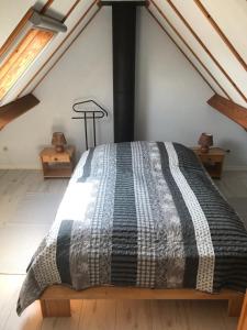 A bed or beds in a room at Zeepark Zeewind