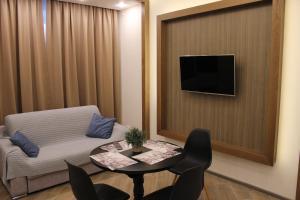 Телевизор и/или развлекательный центр в Мини-отель Уют