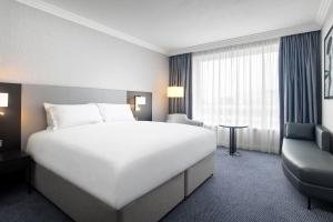 A bed or beds in a room at Sofitel London Gatwick