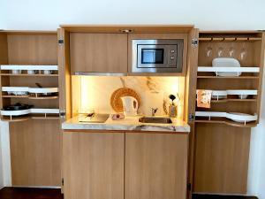A kitchen or kitchenette at ECORKHOTEL Evora