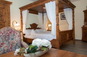 Ein Bett oder Betten in einem Zimmer der Unterkunft Landhotel Altes Pfarrhaus