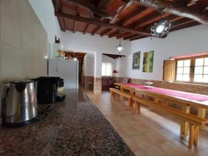 A kitchen or kitchenette at Villa with pool Barbecue