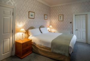 A bed or beds in a room at Hazlewood Castle & Spa
