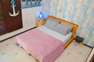 A bed or beds in a room at CanCoq Guest House