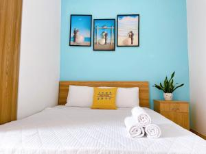A bed or beds in a room at HomeAway - Melody Vung Tau