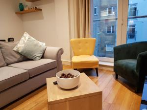 A seating area at Abbots Yard Apartments with Lily Pad Living