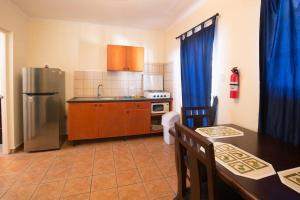 A cozinha ou cozinha compacta de Aquazul Aruba Apartments