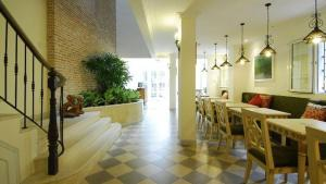 A restaurant or other place to eat at Ma Maison Boutique Hotel