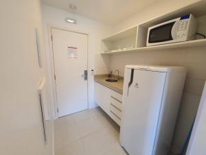A kitchen or kitchenette at Hotel Vision, Setor Hoteleiro Norte