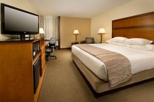 A bed or beds in a room at Drury Inn & Suites Springfield