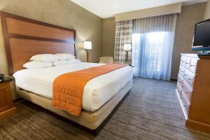 A bed or beds in a room at Drury Inn & Suites Flagstaff