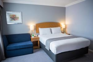 A bed or beds in a room at Holiday Inn Manchester West