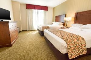 A bed or beds in a room at Drury Inn and Suites Denver Central Park