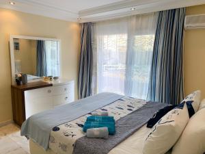 Кровать или кровати в номере Apartments Marine Holiday