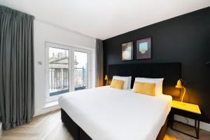 A bed or beds in a room at Staycity Aparthotels, Dublin, Christchurch