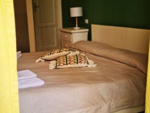 Letto o letti in una camera di Dolce Dormire