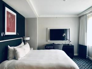A bed or beds in a room at Sofitel Lafayette Square Washington DC