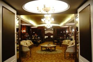 A restaurant or other place to eat at Ramada Plaza, Chandigarh, Zirakpur