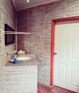A bathroom at La Nature Apartments Au Cap
