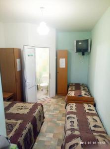 Кровать или кровати в номере Guest House Aura