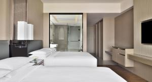 A bed or beds in a room at Kathmandu Marriott Hotel