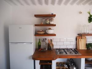 Kuchyň nebo kuchyňský kout v ubytování Casa La Paz-Teepee Barranco