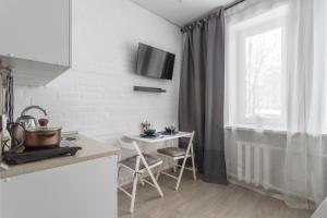 A kitchen or kitchenette at FREEDOM Rooms Vnukovo