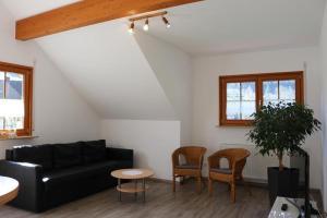 Ein Sitzbereich in der Unterkunft Haus Sum