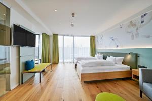 Ein Bett oder Betten in einem Zimmer der Unterkunft Hotel Federwerk