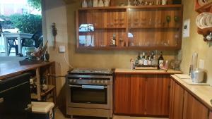 A kitchen or kitchenette at Villa Vista Guest House