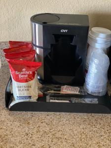 Coffee and tea-making facilities at Cobblestone Hotel & Suites - Broken Bow