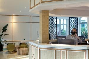 The lobby or reception area at Kimpton Surfcomber Hotel, an IHG hotel