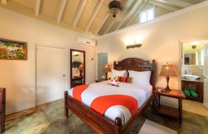A bed or beds in a room at Rosalie Bay Eco Resort & Spa