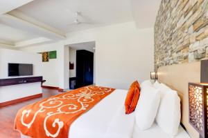 A bed or beds in a room at The Fern Denzong Hotel & Spa Gangtok, Sikkim