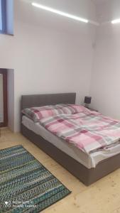 Posteľ alebo postele v izbe v ubytovaní Štúdiá ŠL TANAPu