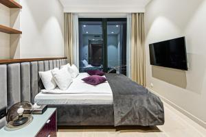 """Кровать или кровати в номере Sky Luxury """"Suite"""", Отельные апартаменты 60 Этаж - Башня Нева"""