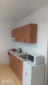 Kuchyňa alebo kuchynka v ubytovaní Štúdiá ŠL TANAPu