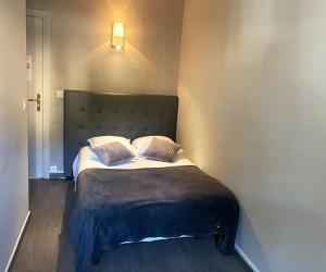 Un ou plusieurs lits dans un hébergement de l'établissement Hôtel La Villa d'Eze