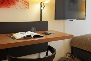 A television and/or entertainment center at Scandic Webers
