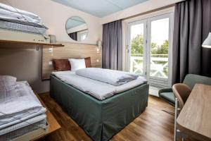 Кровать или кровати в номере Scandic Roskilde Park